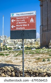 Malta, Mellieha - July 05, 2013 - Street sign showing the way to some popular destinations.