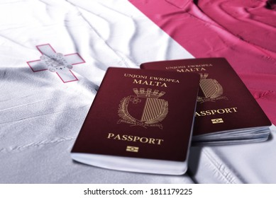 Malta passport on its flag in the background
