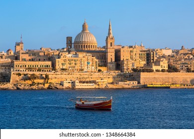 Malta, Valletta, September, 10, 2018-skyline with St. Paul's Anglican Cathedral and Carmelite Church from Sliema,