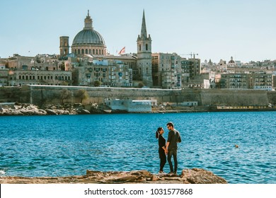 Malta Valletta Skyline Europe, happy couple man and woman at the harbor front of Valletta Malta