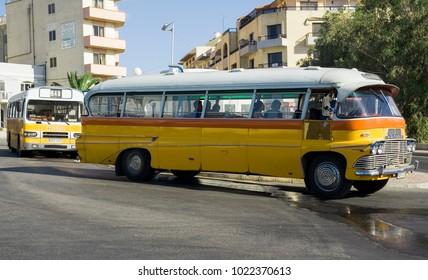 MALTA-SEPTEMBER 7 :Classic vintage buses on the streets of Bugibba ,Malta, on September 7,2007.