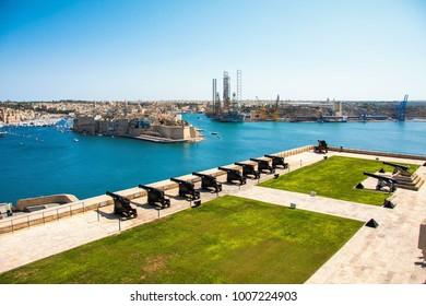 Maltese capital city Valletta. The Saluting Battery of La Valletta and Fort St. Angelo of La Vittoriosa in Malta
