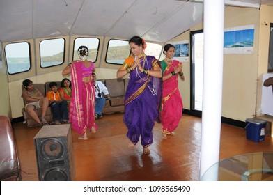MALVAN, MAHARASHTRA, INDIA 24 MARCH 2015 : unidentified actor playing drama or cultural program for foreign tourist catamaran boat near Malvan.