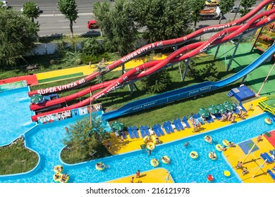 MAMAIA, ROMANIA - AUGUST 27, 2014: Colorful slides and pipes at Aqua Park in Mamaia, Romania, with an area of 4000 square feet of fun pools and water games.