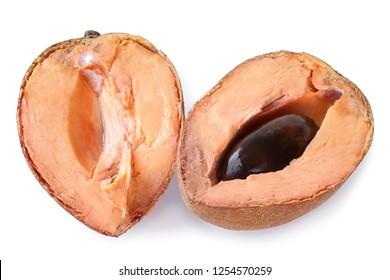 Mamey sapote (Pouteria sapota) fruit cut in half on white background
