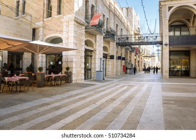 Mamilla road street near Jaffa gate of the old Jerusalem city, Israel. Urban landscape with open cafe tables and beautiful walking street at sunny day. Nice cozy street in the old town of Jerusalem