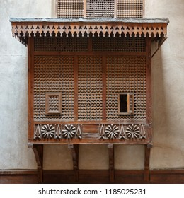Mamluk era style oriel window covered by interleaved wooden grid (Mashrabiya) on stone wall, Facade of the House of Egyptian Architecture historical building, Cairo, Egypt