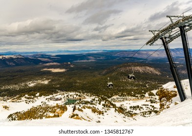 Mammoth Lakes, CA / USA - 03-23-2015: Gondala ride with a view of Sierra Mountains and reservoir at Mammoth Ski Resort in Mammoth Lakes, California.