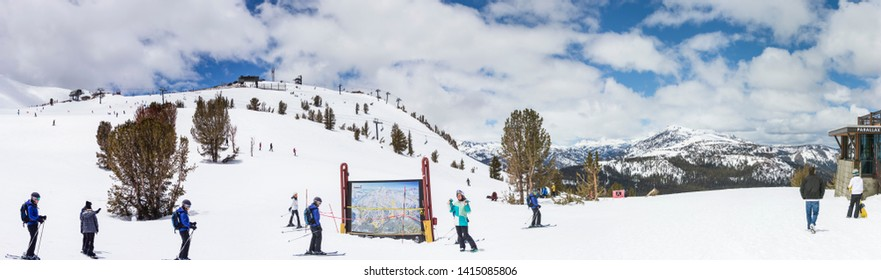 Mammoth Mountain, Mammoth Lake, California USA- May 27 2019: Panoramic of skier at Mammoth mountain with blue sky. Snow background.