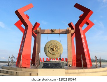 MAMUJU, INDONESIA - OCTOBER 4 2018: A gong which is the icon of Mamuju city which is currently located on Manakarra Beach, West Sulawesi. This place is visited by many tourists