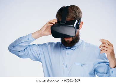 Man in 3d virtual reality glasses plays