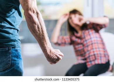Man about to beat up his wife at home