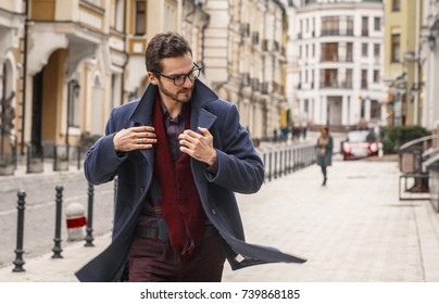 Man about town in old park of the city. Fashion concept
