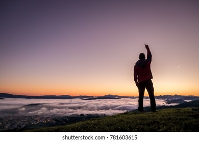 A man above the clouds in a mountain.