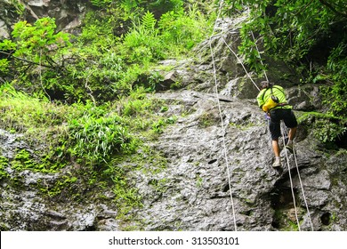 The man abseiling from the top hill.Adventure activity in thailand.