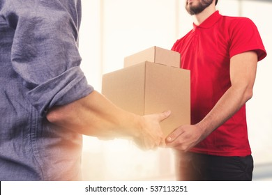 man accepting a delivery of boxes from delivery service courier