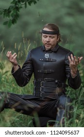 Man actor in the historical leather costume of a knight from the fantasy games