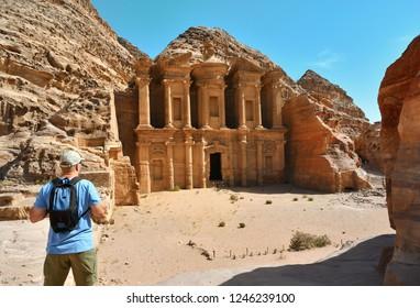 Man in Ad Deir the Monastery Temple in Petra in Jordan