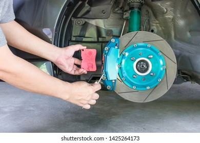 A man adjust bolt for unlock brake pads to change in basic service concept of car with run stop system