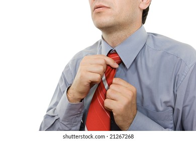 Man adjusting red tie - isolated