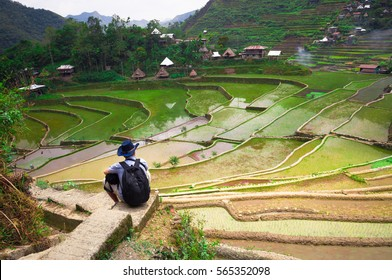 Man admires the beautiful rice terraces.A view of the picturesque rice terraces in the Philippines.Rice terraces of Banaue. Man on the background of beautiful rice terraces.Stunningly beautiful place