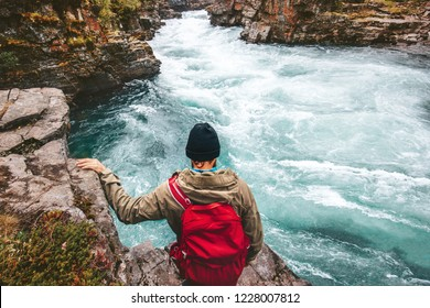 Man adventurer hiking canyoning with backpack alone active lifestyle extreme vacations outdoor river