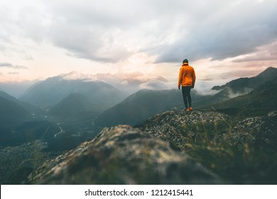 Man adventurer on mountain summit hiking Traveling alone heathy lifestyle active vacations trail running outdoor