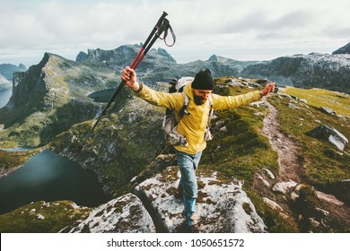 Man adventurer trail running in mountains of Norway Traveling lifestyle adventure success winner concept hiking active summer vacations outdoor