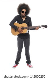 Man with an afro posing with a guitar