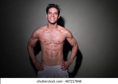 Man after workout, ripped half asian men smiling shirt less, fitness concept