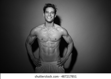 Man after workout, ripped half asian men smiling shirt less, fitness concept , in black and white