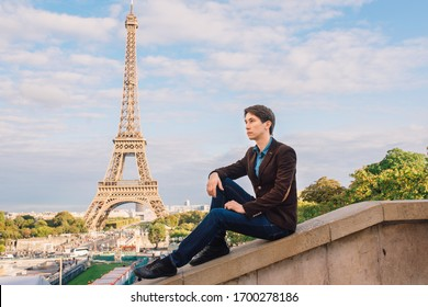 A man against the backdrop of the Eiffel tower in Paris, France.