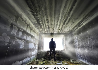 man against the background of a window in a ruined house, horror, fear concept, radiation stalker in Chernobyl zombie apocalypse