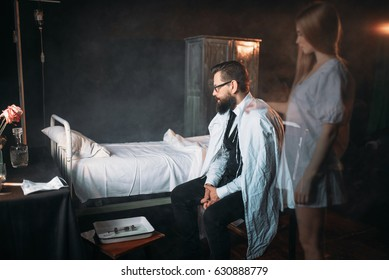 Man against empty hospital bed, soul of dead woman