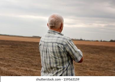 Man aged against  background of sad landscape