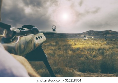 man aiming and shooting at range targets with puffs of dirt from missing target with a retro instagram toned filter