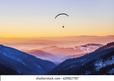 Man in the air - paraglide freedom fly - photo with copy space