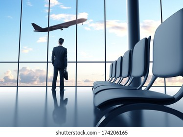 man in airport and airplane in sky