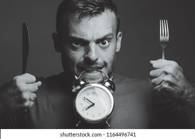 man alarm clock fork and knife