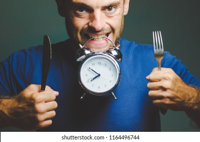 man alarm clock fork and knife