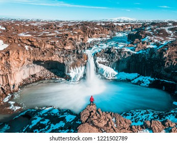 Man at Aldeyjarfoss, Iceland. Tourist at famous waterfall in Iceland.