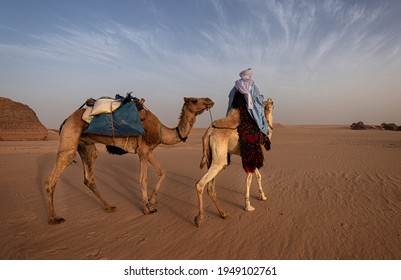 A man from the Algerian Tuareg travelers Photo taken on 01Avril 2021 At eleven oclock fifty-one in the morning  In the Tassili desert Algeria A camel rides carrying food and water