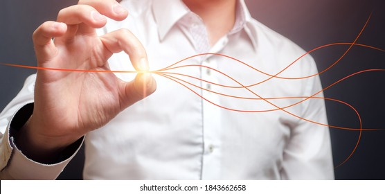 Man aligns branched lines into a single straight. Solving problems and conflicts. Settle things up. Peace of mind, concentration forces to achieve goal. Confidence, success. Simplification planning.