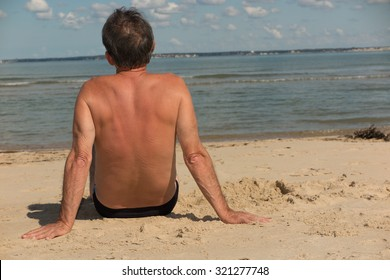Man alone at the beach looking straight away