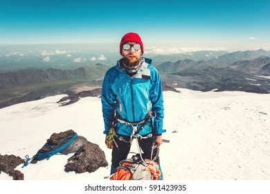 Man alpinist climbing in mountains Travel Lifestyle endurance concept adventure active vacations outdoor mountaineering climbing sport