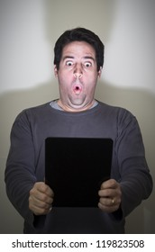 Man is amazed by a digital tablet