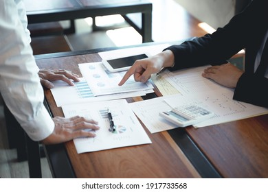 Man Analysis Business Accounting working withIndividual income tax returnAccounting concept.