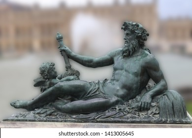 Man and angel statue in Versailles palace