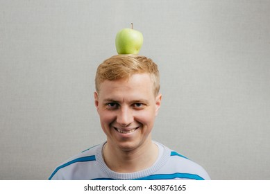 a man with an apple on his head