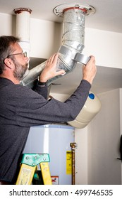 Man applies duct tape to a Hot Water Heater duct